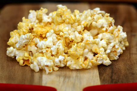 biodiesel: Popped popcorn on wood background