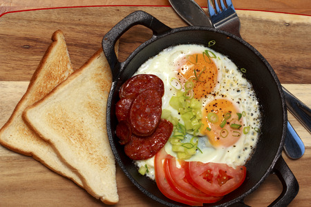 Breakfast Fried eggs with chorizo and Tomato