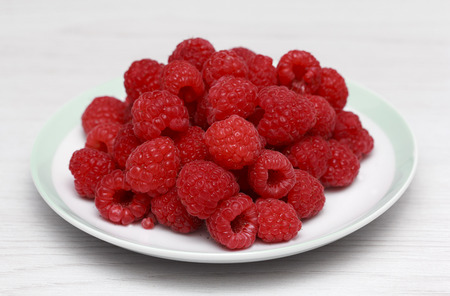 Fresh raspberries in white dish