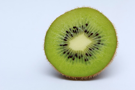 Half of kiwi fruit isolated on white background