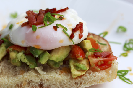 eggs and bacon: Poached eggs bacon tomatoes and avocado on toast