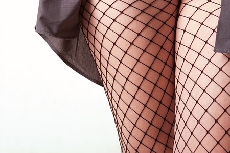 Thigh of a young woman in mesh stockings photo