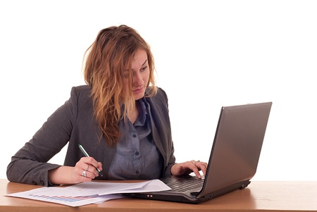 Young blond woman with notebook and documents photo
