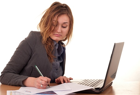 Young blond woman sitting at the computer photo