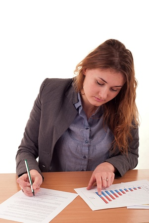 Woman working on office documents photo