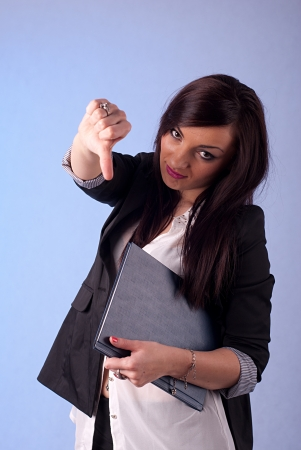 Young beautiful businesswoman shows thumbs down photo