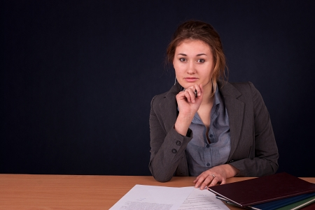 reviewing documents: Young beautiful blonde woman sitting at a desk reviewing documents
