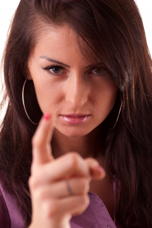 Beautiful brunette dressed elegantly threatening finger  photo