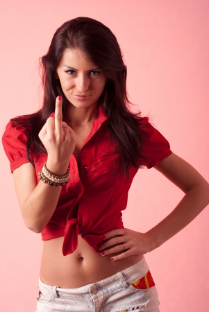 Lady in red showing middle finger photo