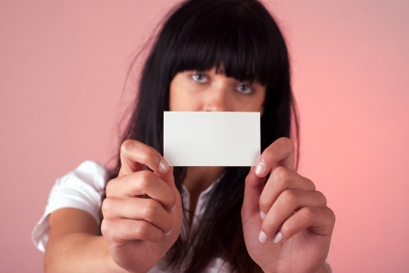 businesscard: Pretty young businesswoman with blank businesscard