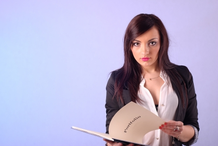 Beautiful businesswoman with a book photo