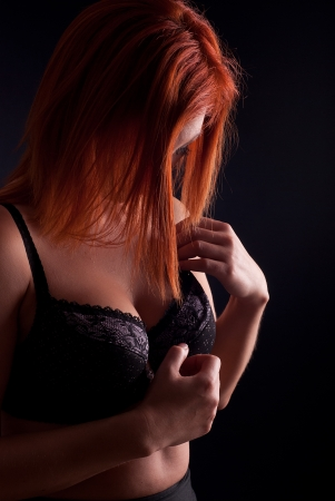 Sexy redhead woman in lingerie photo