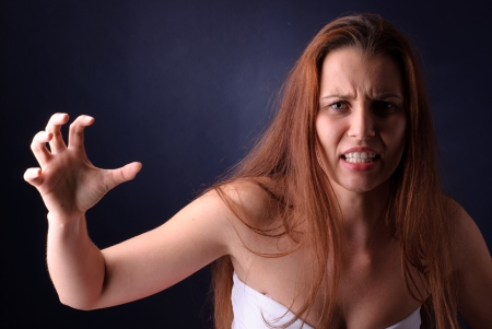 Young beautiful woman in a rage photo