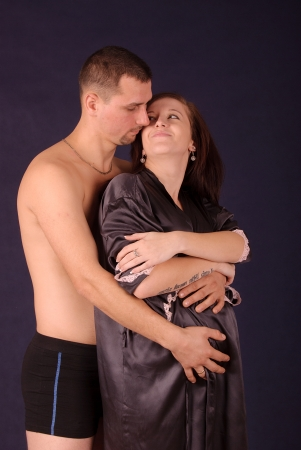 Beautiful, happy   young pregnant couple photo