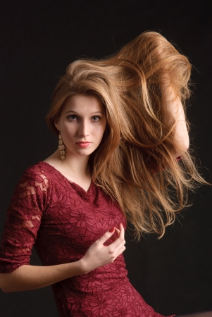 Young woman with long blond hair photo