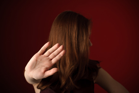 Woman with hand signaling to stop