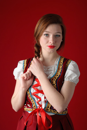 Young beautiful woman in Polish folk costume photo