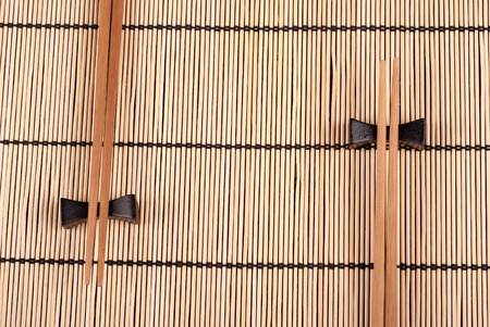 Chopsticks lying on a bamboo mat photo