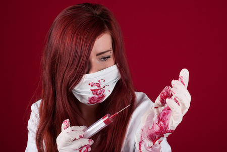 sexy nurse in a bloodstained uniform photo
