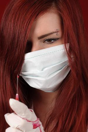 Sexy nurse with a syringe