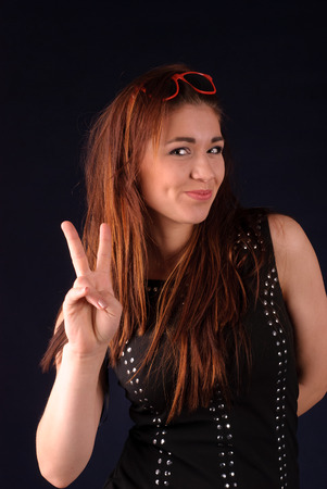 Beautiful brown-haired woman showing peace sign photo
