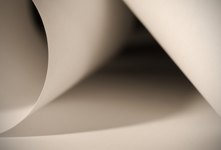 An abstract closeup photo of curve shapes made up of white paper photo