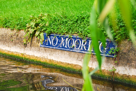 sign no mooring on the bank of the river Cam in Cambridge photo