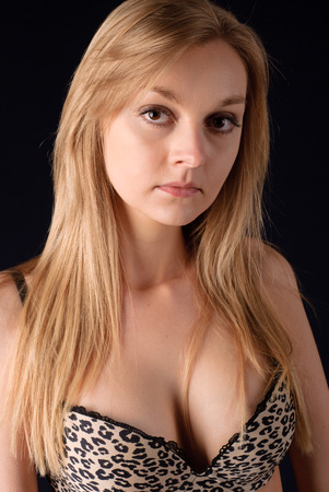 Young pretty blonde woman in leopard bra photo