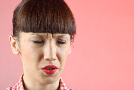 Pretty pin-up brunette woman in checkered shirt crying photo