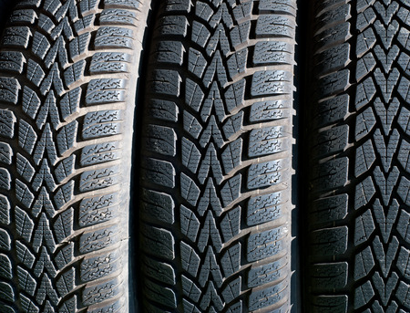 mud and snow: Stack of used winter (mud and snow) tires Stock Photo