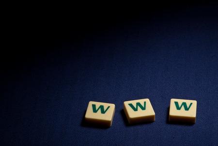 World wide web www plastic letter symbol on dark blue background  Stock Photo