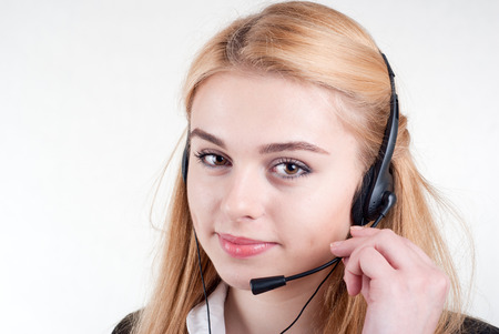 Beautiful blond business woman with headset  Call Center Operator photo
