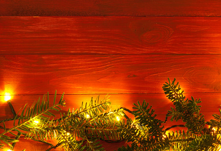 vintage red planked wood with lights and fir twigs and free text space photo