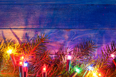 Christmas rustic background - vintage blue planked wood with lights and free text space photo
