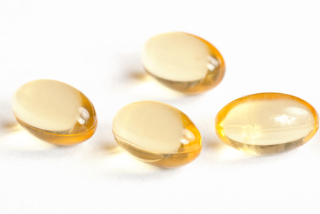 Close up of yellow capsules with shark liver oil