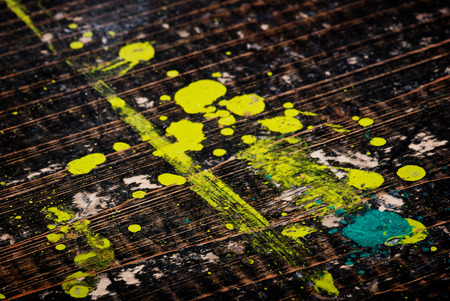 Dirty painted old black wooden desk photo