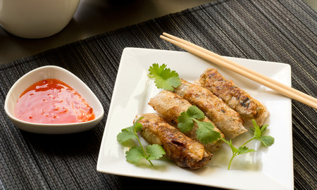 nem: Nem - homemade spring rolls with chili sauce and fresh coriander - vietnamese cuisine Stock Photo