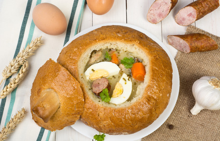 Traditional Polish sour rye soup in a bowl made of bread