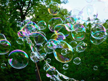 Multicolored big soap bubbles outdoors - natural background Banco de Imagens