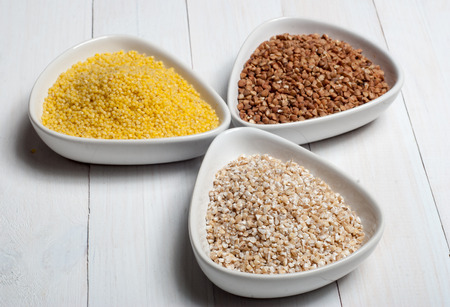 groats: Set of groats from barley, millet and buckwheat