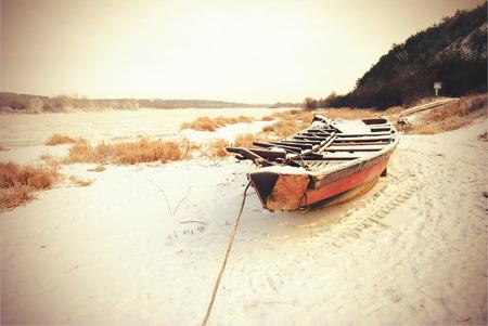 kazimierz: Wooden boat on Vistula river bank near Kazimierz - vintage effect