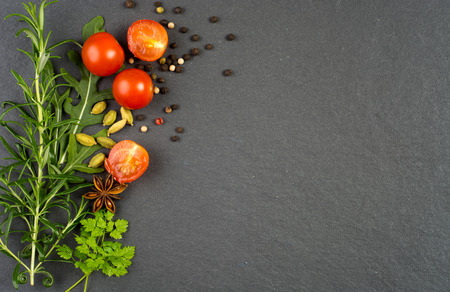 seasonings: Fresh green herbs and seasonings on black slate background Stock Photo