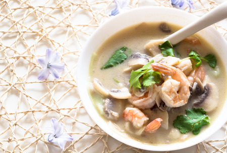 asian food: Fresh Thai thom kha spicy soup with prawns and mushrooms