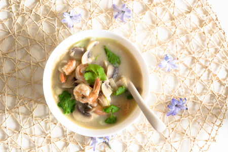 thailand food: Fresh Thai thom kha spicy soup with prawns and mushrooms