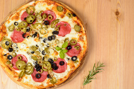 jalapeno pepper: Fresh baked pizza with salami olives and jalapeno pepper Stock Photo