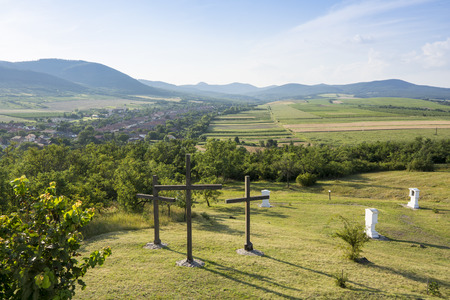 crucifixes: Three crucifixes in calvary in Hercegkut near Sarospatak Hungary - sunlight and landscape