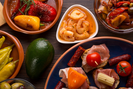 jambon: Top view of variety of mediterranean starters - spanish tapas with shrimps and jambon