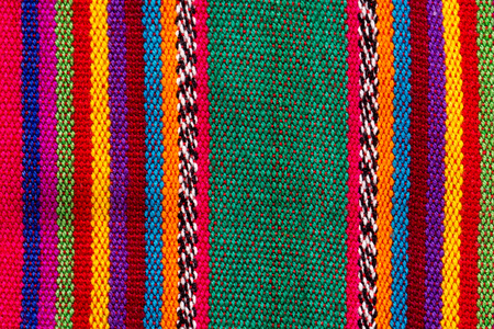 Original fabric Mayan tribes in colorful stripes for texture or background