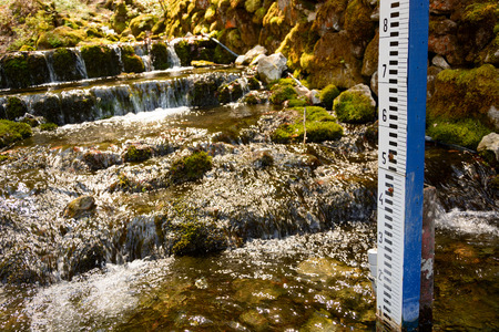 depth gauge: Water gauge on forest stream in Slovak Karst Stock Photo