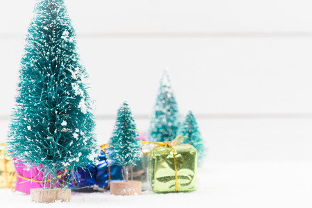 small artificial christmas trees and gifts in boxes with copy space stock photo 83474696 - Small Artificial Christmas Tree